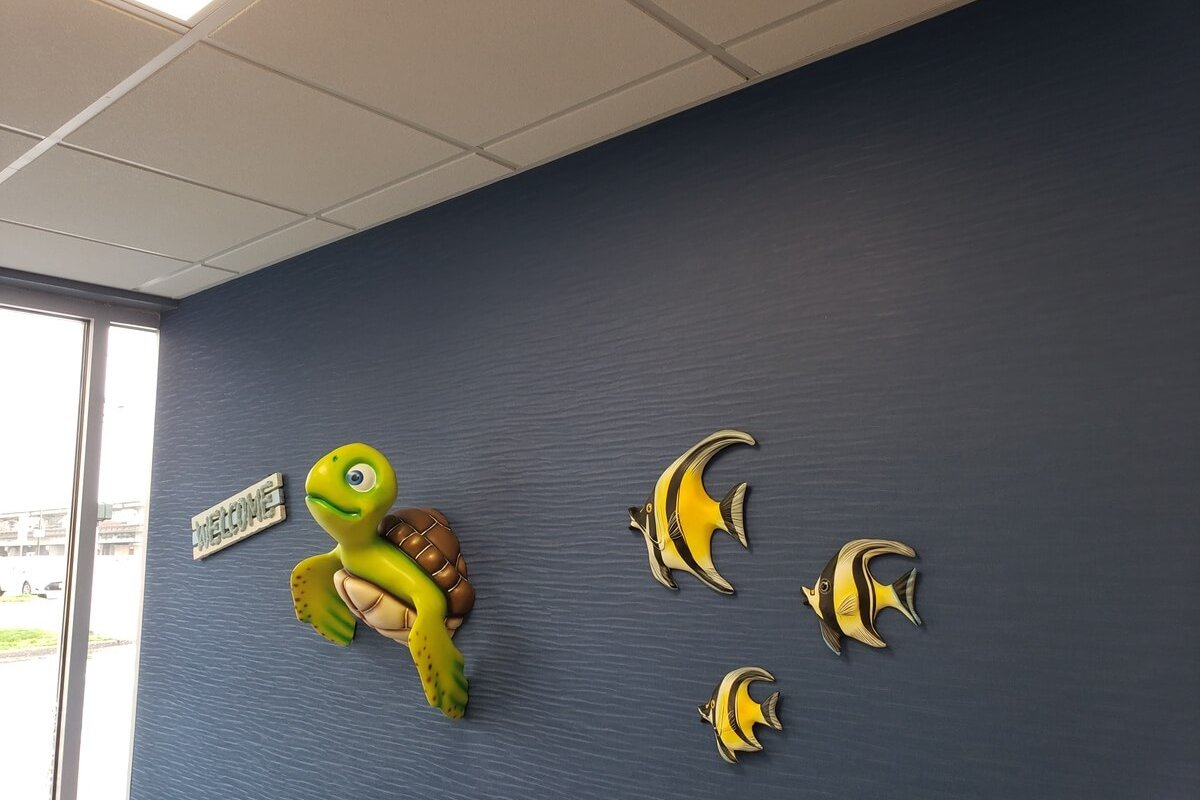 sea turtle and tropical fish on blue wall