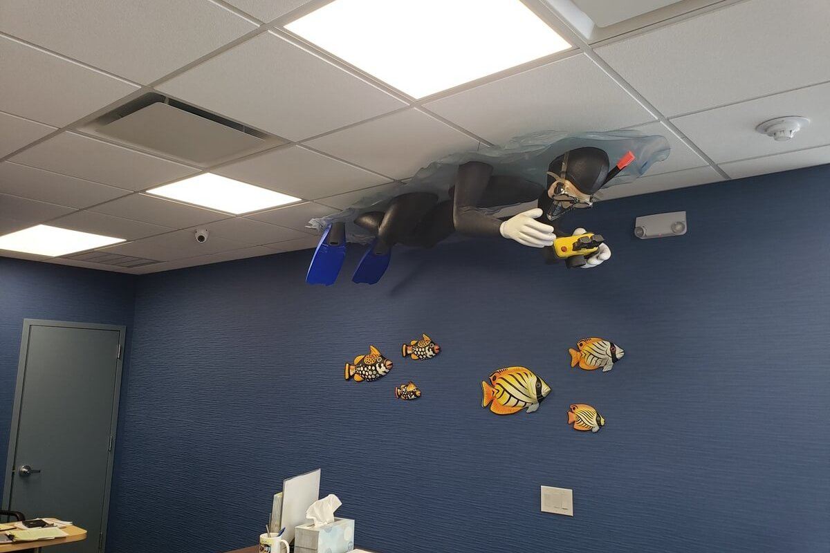 scuba diver hanging from ceiling in dental office
