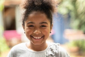 Child Smiling With Dental Sealants