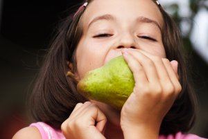 Little Girl Eating Pear