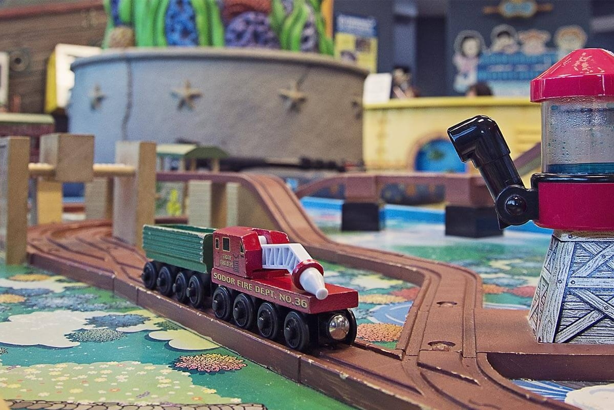 toy train on wooden track