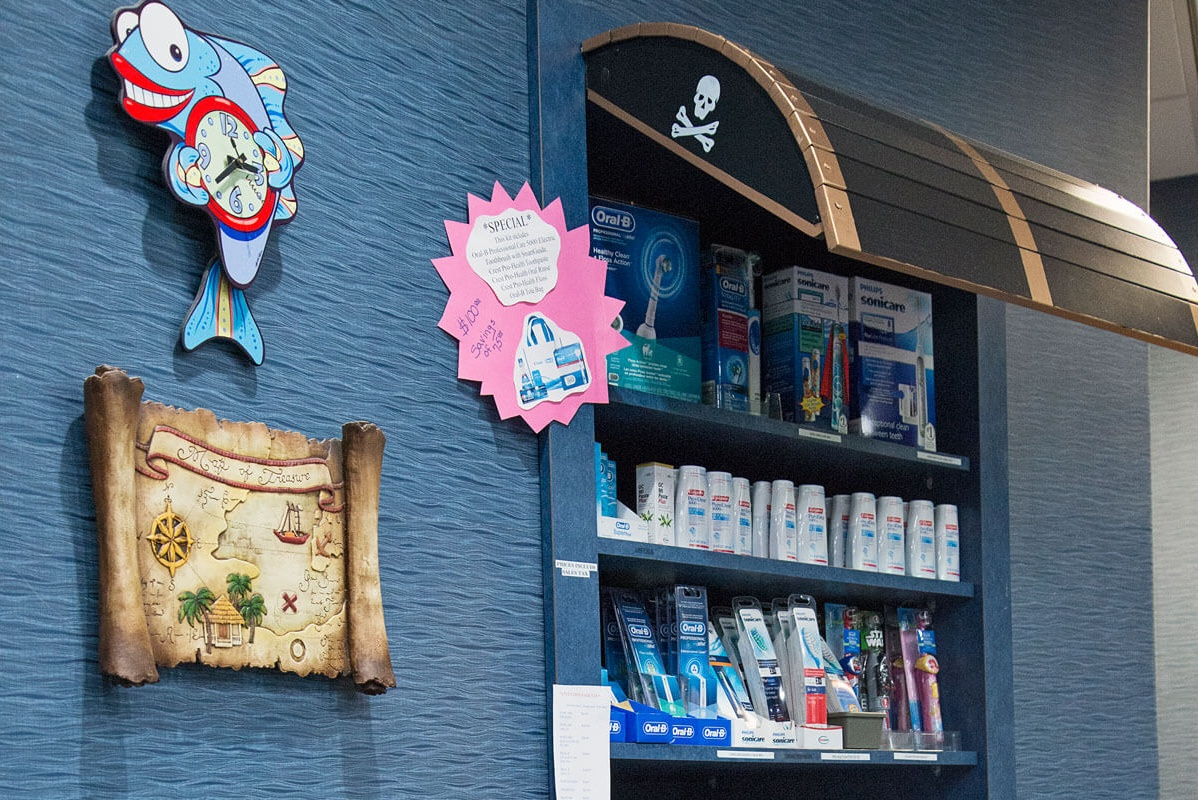 treasure chest shelves stocked with dental supplies