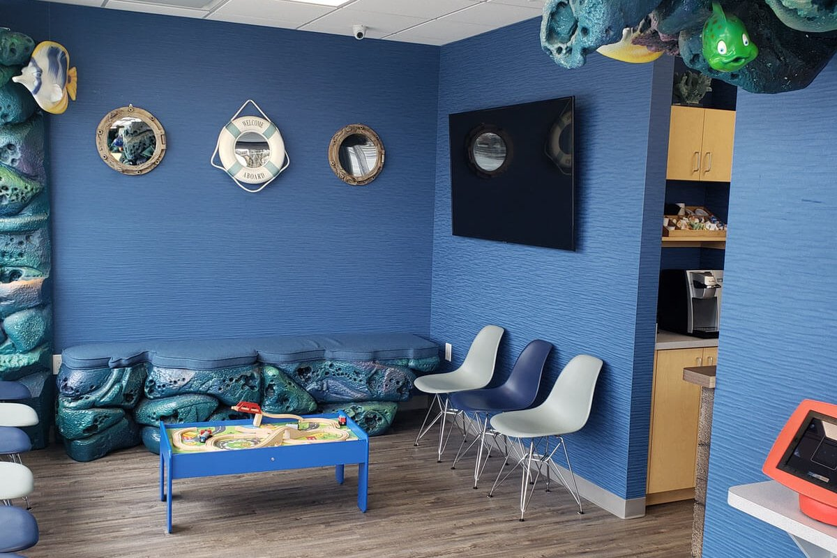 nautical themed waiting area with blue and white chairs